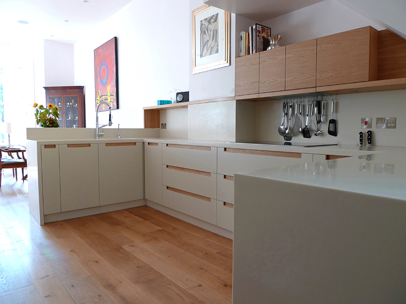 The spray finished doors are carefully matched in colour to the corian so that the bespoke handles and main feature stand out in contrasting detail. & Kensington - 56 North Bespoke Kitchens